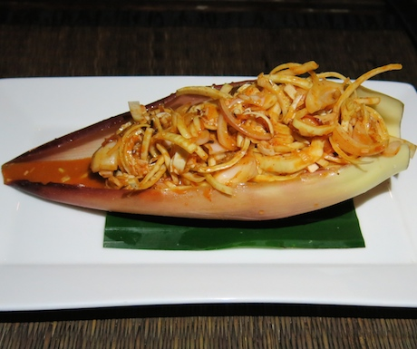 Shredded banana blossom and toasted coconut in a spicy coconut milk, tamarind and lime dressing.