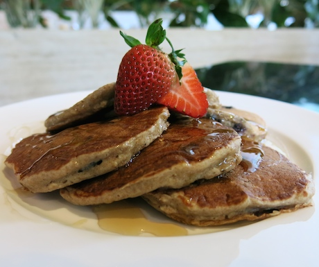 vegan pancakes with juicy blueberries and maple syrup drizzled over the top at Sheraton Towers Singapore