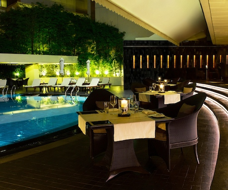view of the swimming pool at Regent Singapore from Basilico