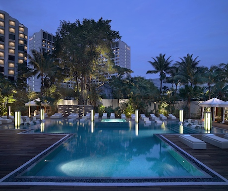 Relax by the pool at The Grand Hyatt.