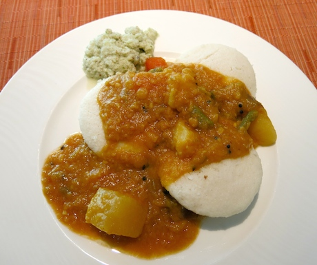 Delicious Southern Indian idly (steamed rice flour pancakes), sambar (lentil stew) and coconut chutney.