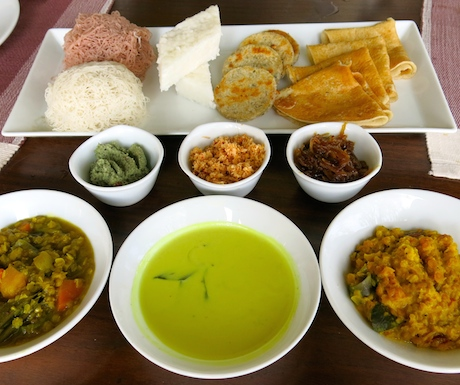 A wonderful array of string hoppers, milkrice, cocnut roti and dosai with sambals, kiri hodi, curry and dahl.