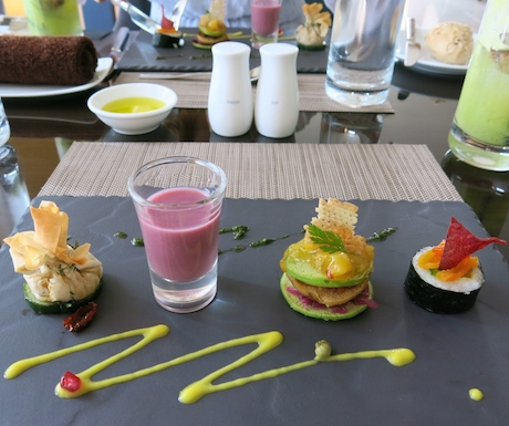 PICTURE OF STARTER (HUMMUS PARCEL< BANANA BLINIS< POMEGRANITE SOUP)
