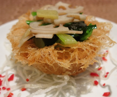 Crispy yam ring filled up with wok fried lotus root and celery, then seasoned with Taiwanese basil.