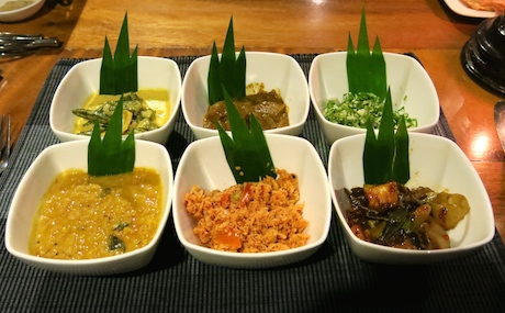 A selection of wonderful plant-based curries and a herbal coconut salad, served with steamed rice and papadums.