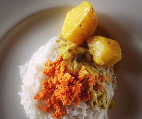 String hoppers with spicy pol sambl and kiri hodi potato curry.