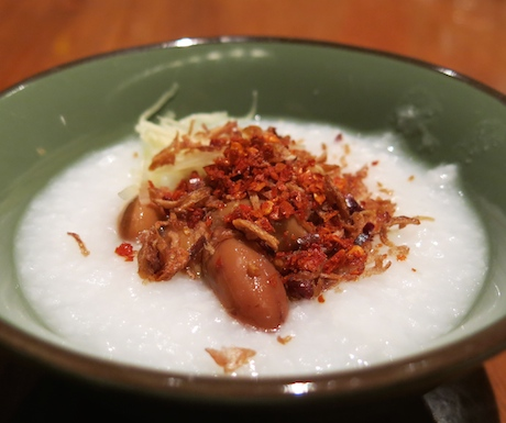 Shredded ginger, braised peanuts, crispy shallots, chilli and soy with vegan congee at Grand Hyatt Singapore