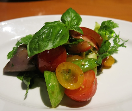 Green zebra tomatoes, brown kumatos, yellow cherry tomatoes and pickled eggplant in a basil vinaigrette.