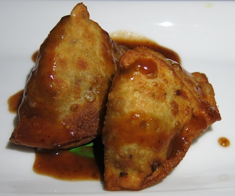 Delicious homemade samosas with tamarind sauce.