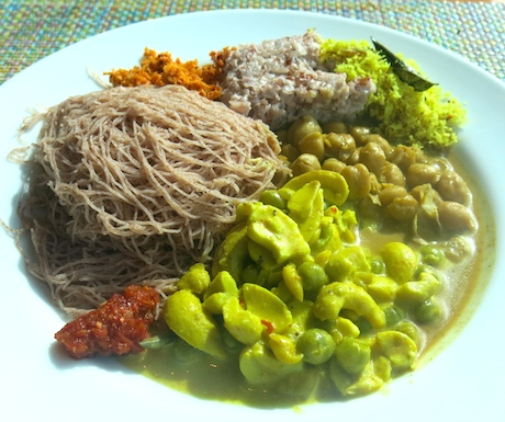 vegan cashew curry and a chick pea masala with string hoppers, kiribath and sambols for breakfast at Cinnamon Red