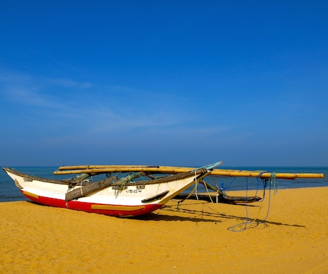 Golden sand and blue sky on Negombo Beach