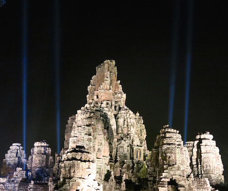 Blue lights pointing high into the sky from Angkor Thom.