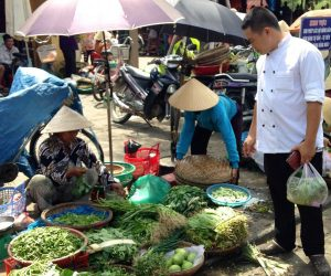 shopping for fresh herbs and vegetables in Vietnam