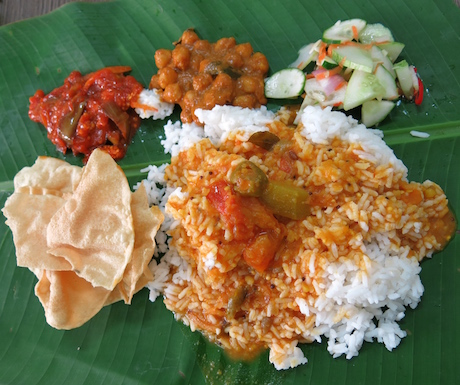 Every vegan's friend in Malaysia - a banana leaf piled high with tasty, spicy curries which is topped up until you're full.