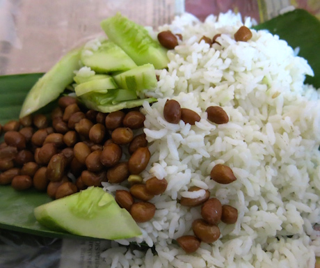 Takeout vegan nasi lemak; amazing coconut creamy, pandan scented rice with cucumber and peanuts to garnish.