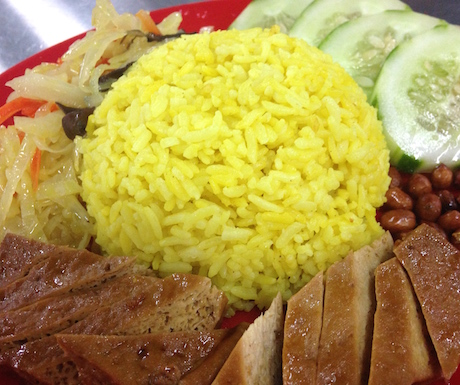vegan nasi lemak where the rice is cooked with turmeric, served with 5 spice braised tofu