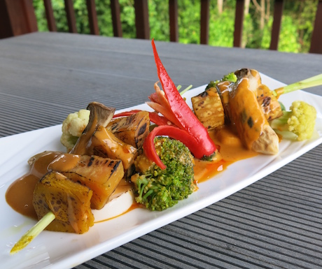 Spicy Penang sauce ladled over lemongrass pumpkin skewers with tofu at Chams House