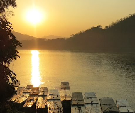 Amazing sunsets like this await you in Laos.