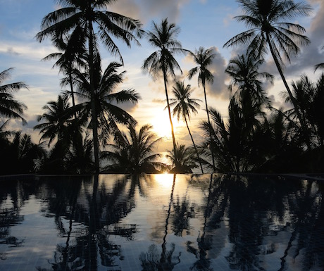 Beautiful sunset reflecting on the infinity pool.