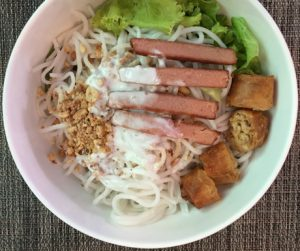 White noodles with crispy spring rolls, rice noodles and mock meat at Yuan Sheng Vegetable Restaurant in Siem Reap