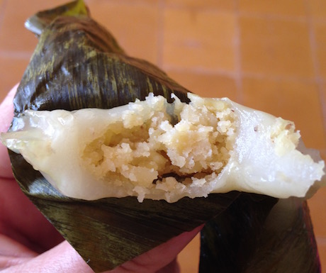 Rice with sweet yellow bean paste roasted in banana leaf