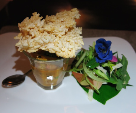 Braised mushrooms with coconut milk and peanuts, puffed rice, herbs, flowers and local crudités.