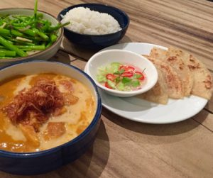 ofu curry with sides of roti and morning glory at Jann Bai
