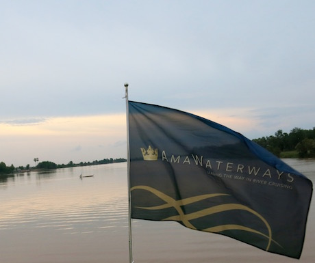 AmaWaterways flag flying over the Mekong River.