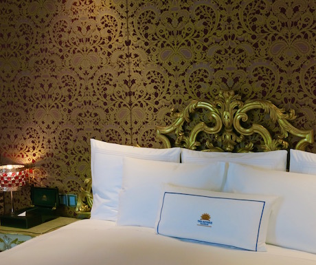 Wonderful wallpapers, luxurious linens; bedrooms at The Reverie Saigon are incredible