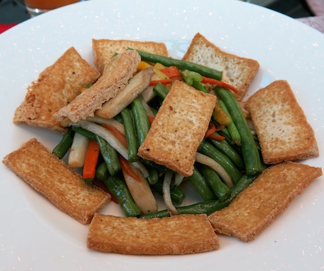 Slithers of crispy fried tofu on crunchy wok fried vegetables for breakfast at The Reverie Saigon