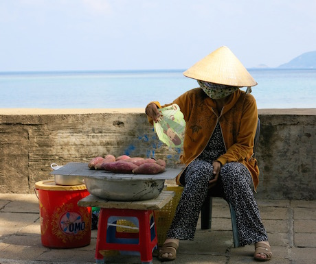 street vendor selling sweet potatoes at the seafront on Con Dao