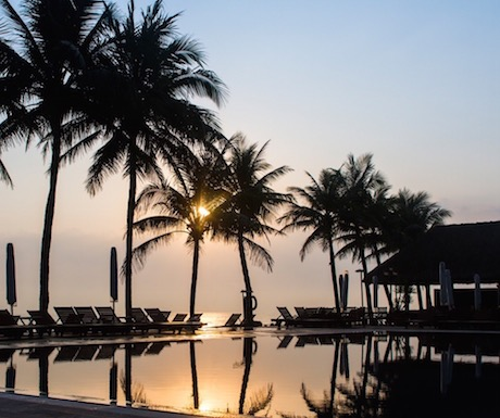stunning sunrise over the swimming pool at Victoria Hoi An Beach Resort