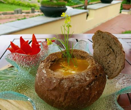 vegan soup in a freshly baked loaf of bread