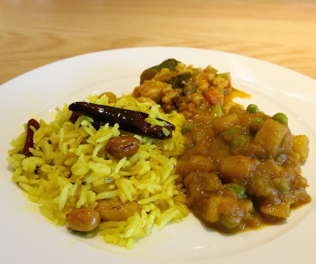 Duo of vegetable curries with pilau rice.