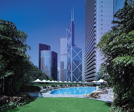 Surrounding skyscrapers tower over the pool area.