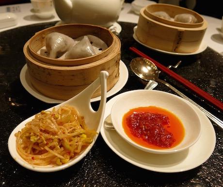 Vegetarian dumplings with black truffle pesto.