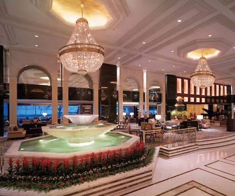 The grand reception area at Kowloon Shangri-La with huge chandeliers and paintings