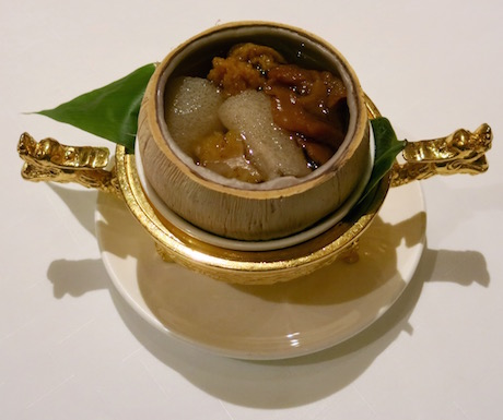 Double-boiled wild fungus with bamboo pith and cabbage served in a young coconut at Shang Palace.