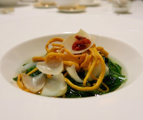 Coddled pea sprout and lily bulbs with cordyceps flower in clear vegetable broth at Shang Palace.