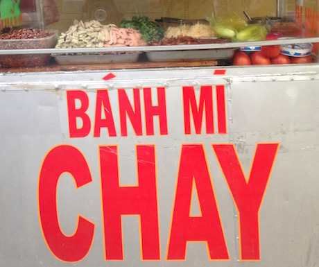 banh mi chay in bright red letters on food cart in Nha Trang