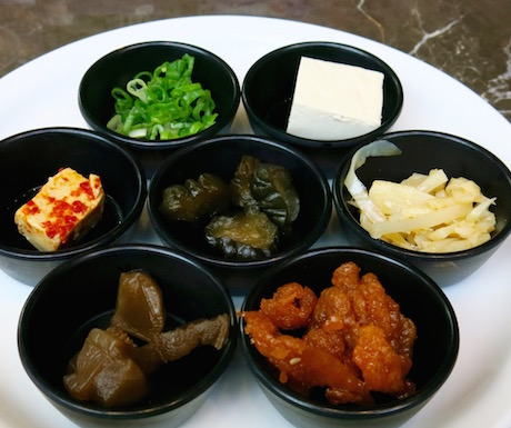huge selection of vegan congee condiments at Regent Taipei