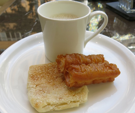 Traditional Taiwanese breakfast of sesame pastry and youtaio served with warm, sweet soy milk.