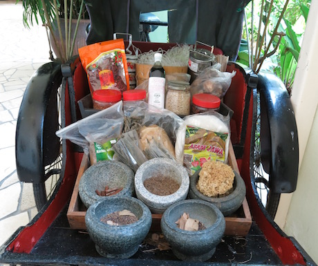 A traditional rickshaw, filled with ingredients used to cook local food at PARKROYAL Penang Resort