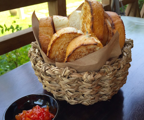 Basket of bread with homemade papaya jam.