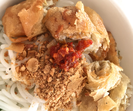 Crispy vegan fried spring rolls sat atop a fresh herb and noodle salad with a healthy bit of chilli paste, go and try the 'banh sung' at Mie Gala.