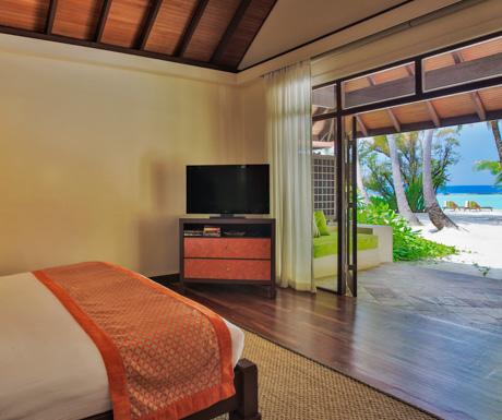 beachfront deluxe bungalow beach at Kurumba Maldives