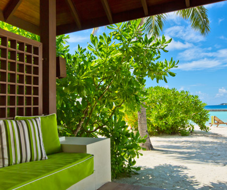 sofa outside the beachfront deluxe bungalow