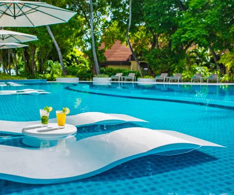 Chill by the pool at Kurumba Maldives