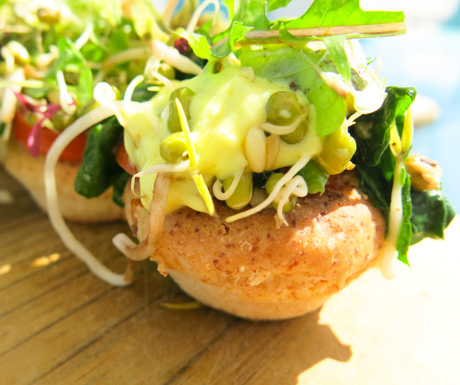 Corn muffins with peanut butter, wilted greens, micro sprouts and tofu hollandaise.