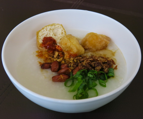 Bowl of congee with all of the trimmings